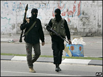 Masked Hamas militants man a checkpoint in Gaza City