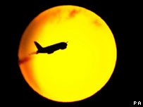 Aircraft flying in front of the Sun (Image: PA)