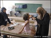 Doctor examines girl in Beirut