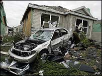 A destroyed car sits in the garden of a house in The Villages, Florida
