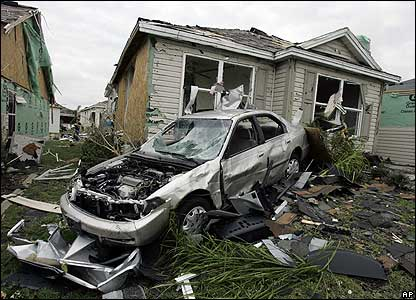 A car destroyed by a tornado outside a house in The Villages, Florida