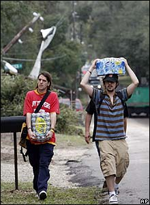 Two men carry water supplies