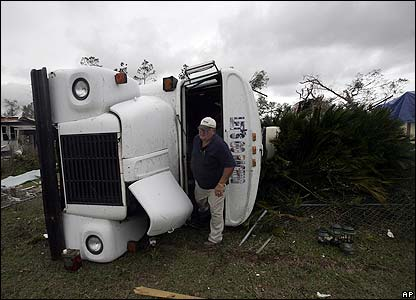 A man with an upturned bus in Lady Lake.