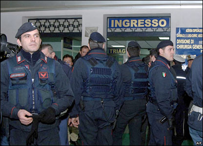 Police officers stand outside Garibaldi Hospital