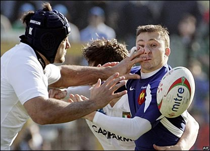 France scrum-half Pierre Mignoni is tackled