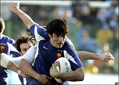 France's replacement fly-half David Skrela carries the ball