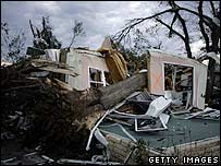 A tree lies on top of a crumpled house in Lady Lake, Florida