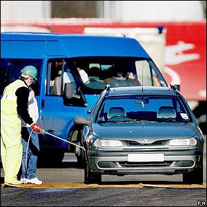 A car being sprayed clean