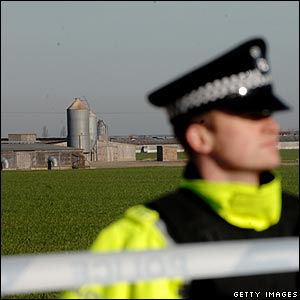 Police cordon with factory in background