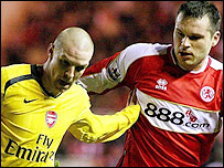 Arsenal centre-back Philippe Senderos (left) fends off Boro striker Mark Viduka