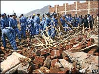 Rescue workers at site of a previous Mumbai building collapse