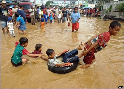 Children play in floodwater in Jakarta