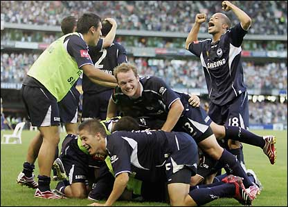 Melbourne Victory's players celebrate