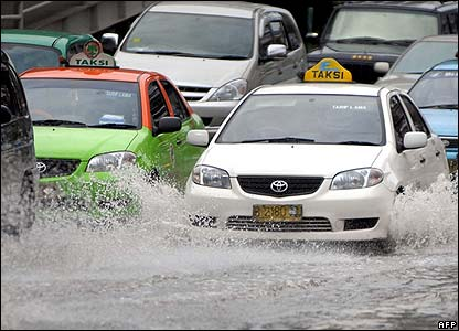 Taxis driving through flooded streets