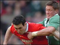 Wales fly-half Stephen Jones is tackled by opposite number Ronan O'Gara