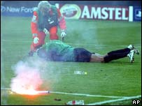 AC Milan's goalkeeper Dida is hit by a missile in a Milan derby in 2005