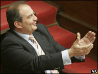 Greek PM Kostas Karamanlis applauds during a parliamentary debate