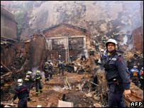 Chilean firefighters clear the debris from the Valparaiso fire