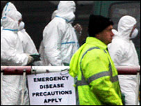 Workers in protective suits at the Bernard Matthews factory farm in Holton, Suffolk