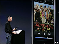 Apple CEO Steve Jobs demonstrates the new iPhone playing a Beatles song during his keynote address at MacWorld Conference