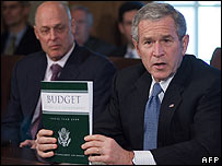 US President George W Bush holds a copy of the 2008 Fiscal Budget