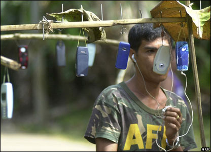 Filipino marine with mobile phones in southern island of Jolo