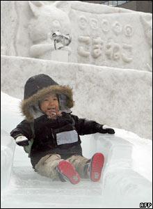 Boy on an ice slide in Sapporo, Japan