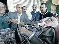 Torbi el Mekki touching a sick woman