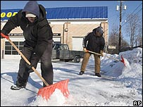 Two men shovelling snow in Colorado