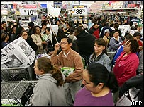 People shopping in Wal-Mart store in California