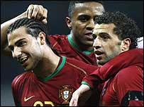 Portugal players celebrate Simao's opener