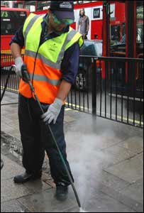 Man cleaning pavement
