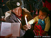 A priest holds a christening for a baby in Yunnan, 2006