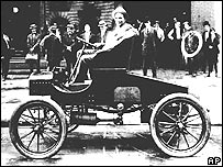 Henry Ford in one of his cars in the early 1900s