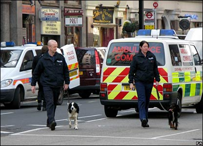Police officers with sniffer dogs at Victoria letter bomb scene