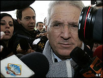 Italian Soccer League President Antonio Matarrese is mobbed by reporters upon his arrival at a Rome Fiumicino airport hotel for a meeting with soccer league officials