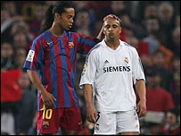 Barcelona star Ronaldinho (left) and Real Madrid's Roberto Carlos