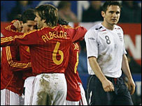Spain's players celebrate their goal as Frank Lampard looks on
