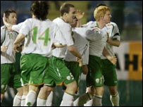 Irish players celebrate the winning goal