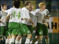 Irish players celebrate the winning goal