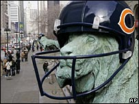 A lion at Chicago's Art Institute wears a Chicago Bears helmet