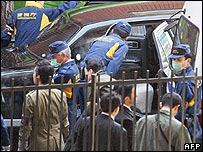 Police at the scene of the shooting of a gang boss in Tokyo on 5 February 2007