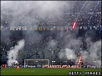 Flares thrown on the pitch at the San Siro stadium