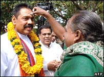 Selliah Parameswar (right) applies ash to the forehead of President Rajapakse on 3 February