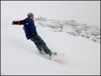 Salesman Luke Rutter snowboards on old slag heaps near Blaenavon