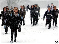 Schoolchildren playing in snow
