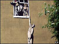 Banksy art painted on a building in Bristol