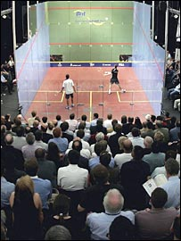 Crowds watch a squash match in London
