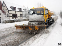 A snow plough clears the road in the village of Norton near Worcester