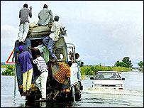 Car drives through floods (file photo)